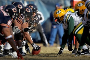 CHICAGO, IL - JANUARY 23: Center Olin Kreutz #57 of the Chicago Bears prepares to snap the ball against the Green Bay Packers in the first half of the NFC Championship Game at Soldier Field on January 23, 2011 in Chicago, Illinois. (Photo by Jamie Squire/Getty Images)