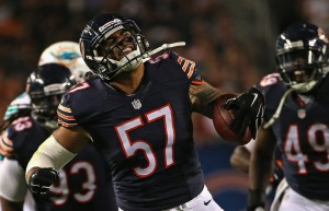 CHICAGO, IL - AUGUST 13: John Timu#27 of the Chicago Bears celebrates after itercepting a pass against the Miami Dolphins during a preseason game at Soldier Field on August 13, 2015 in Chicago, Illinois. The Bears defeated the Dolphins 27-10. (Photo by Jonathan Daniel/Getty Images) 565363365