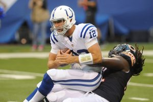 Aug 22, 2015; Indianapolis, IN, USA; Indianapolis Colts quarterback Andrew Luck is sacked by Chicago Bears linebacker Pernell McPhee (92) at Lucas Oil Stadium. Mandatory Credit: Thomas J. Russo-USA TODAY Sports