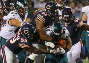 CHICAGO, IL - SEPTEMBER 19: Danny Trevathan #59 and Akiem Hicks #96 of the Chicago Bears stop Ryan Mathews #24 of the Philadelphia Eagles at Soldier Field on September 19, 2016 in Chicago, Illinois. The Eagels defeated the Bears 29-14. (Photo by Jonathan Daniel/Getty Images) ORG XMIT: 659050167