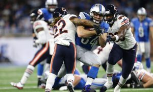 DETROIT, MI - DECEMBER 11: Zach Zenner #34 of the Detroit Lions battles for yardage against Cre'von LeBlanc #22 of the Chicago Bears and Adrian Amos #38 during third quarter action at Ford Field on December 11, 2016 in Detroit, Michigan. (Photo by Rey Del Rio/Getty Images)